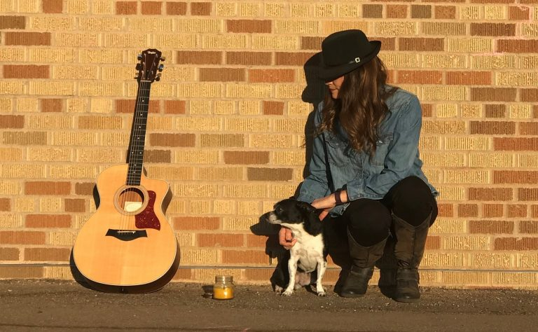 Woman, dog candle and guitar